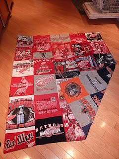 Probably the best tutorial I've read, and almost all shirts are from a thrift store- my kind of craft!! Now I need to learn how to sew...  gigantic Red Wings and Tigers t-shirt blanket.