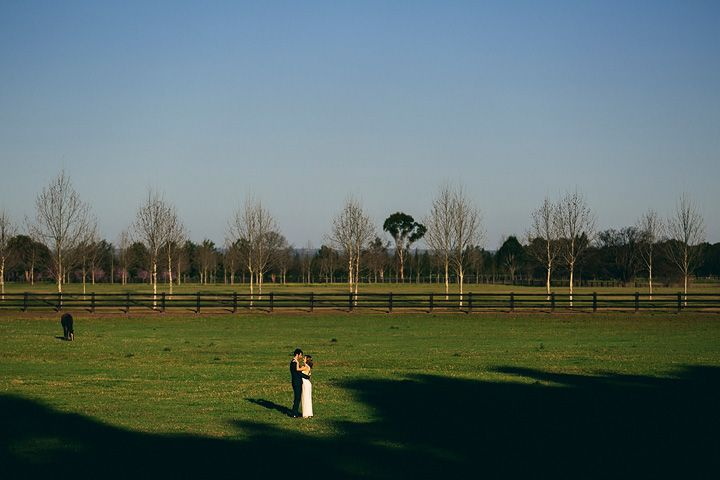A newly married couple out in the paddock at Sydney Polo Club. Peter D Photography