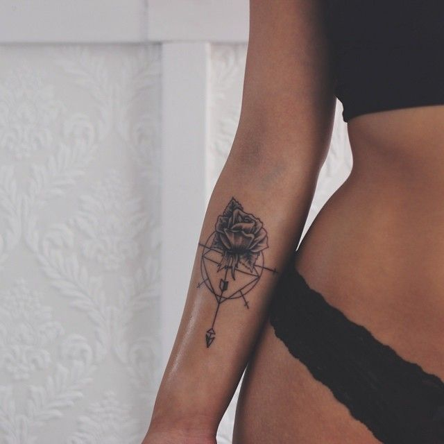 Rose, diamond, and arrow tattoo