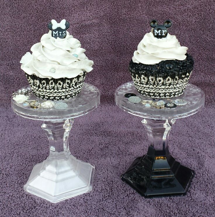 Bride and groom faux cupcakes, embellished with various cabachons. Finished with a metallic shimmer and glitter. The glass cupcake stands are also embellished with cabachons. The glass has been painted with coordinating colors. Created by Sara Landin