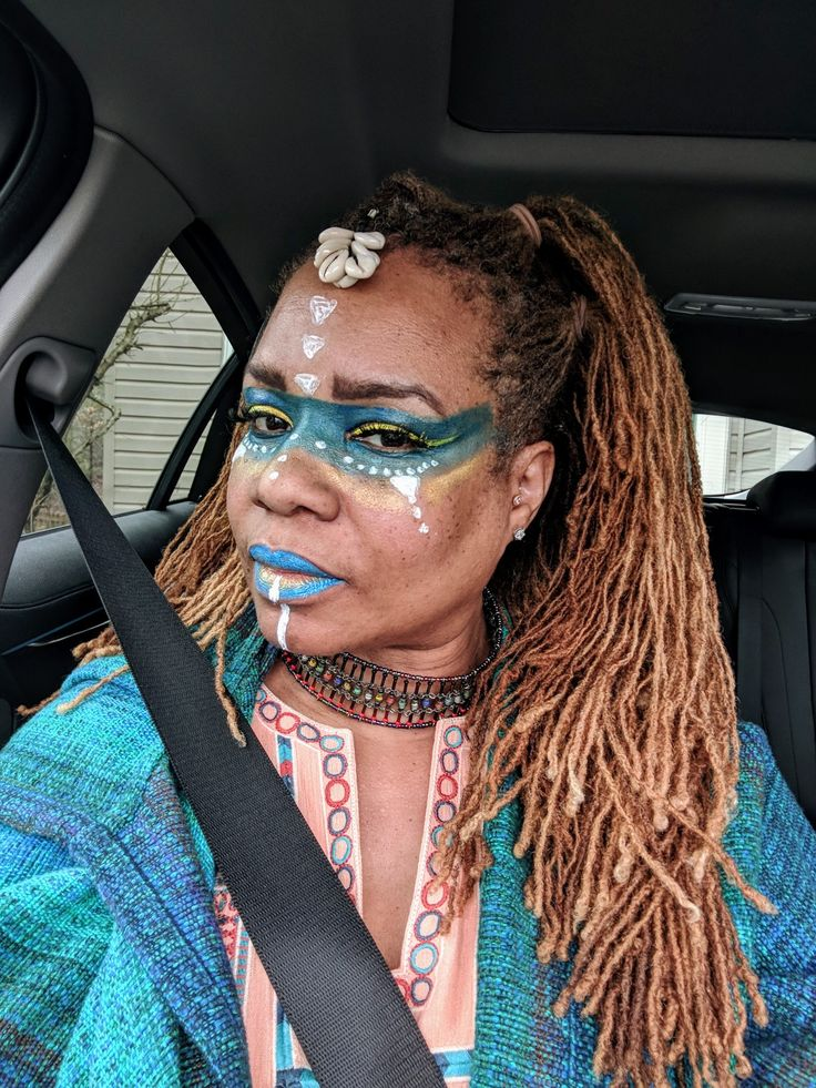make up by me gigisparky inspired by #BlackPanther #melaningoddesses #wakandaforever #locs #goldenlocs #sisterlocks. I used Urban Decay eyeshadow, Makeup Forever eyeshadow, Nars Man Ray lip glass in Muse, matt lipstick by Kiss NY Egoism in Mighty Mimosa and white face paint.