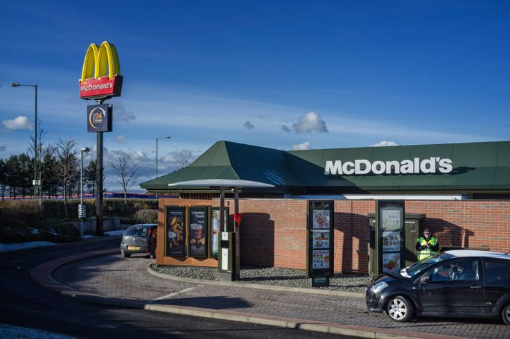 """FAST food giants McDonald's is trialling a """"walk-thru"""" – for weekend revellers who have drunk too much to drive. An outlet in Llandudno, North Wales, has opened a lane for pedestrians to serve hungry diners leaving a nearby nightclub in the early hours. Between the hours of 2.30 and 4am, customers will be able to walk through a separate lane and order meals."""