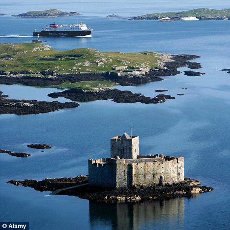 Breathtaking: The ferry arrives at Castlebay, with Kisimul castle in the foreground