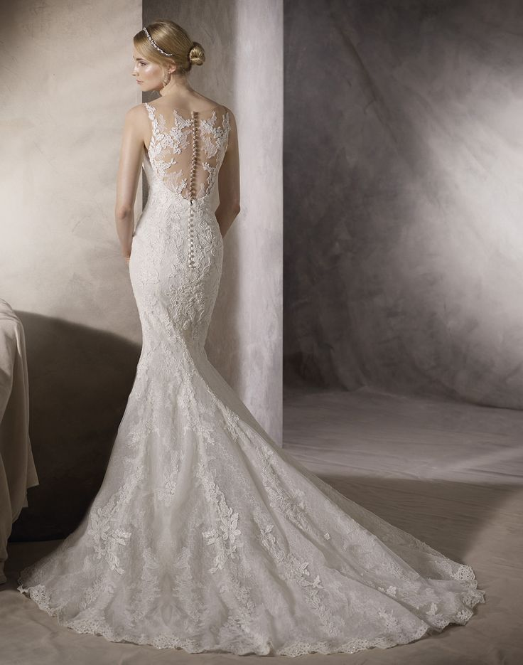HACINE // A luxurious wedding gown is created from embroidered tulle, Chantilly lace and the finest guipure, and then finished with intricate beading