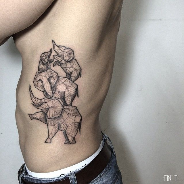 Forgot to post this one up- FINALLLYYY got to finish this #geometric #elephant family on Chris' ribs - fintattoos