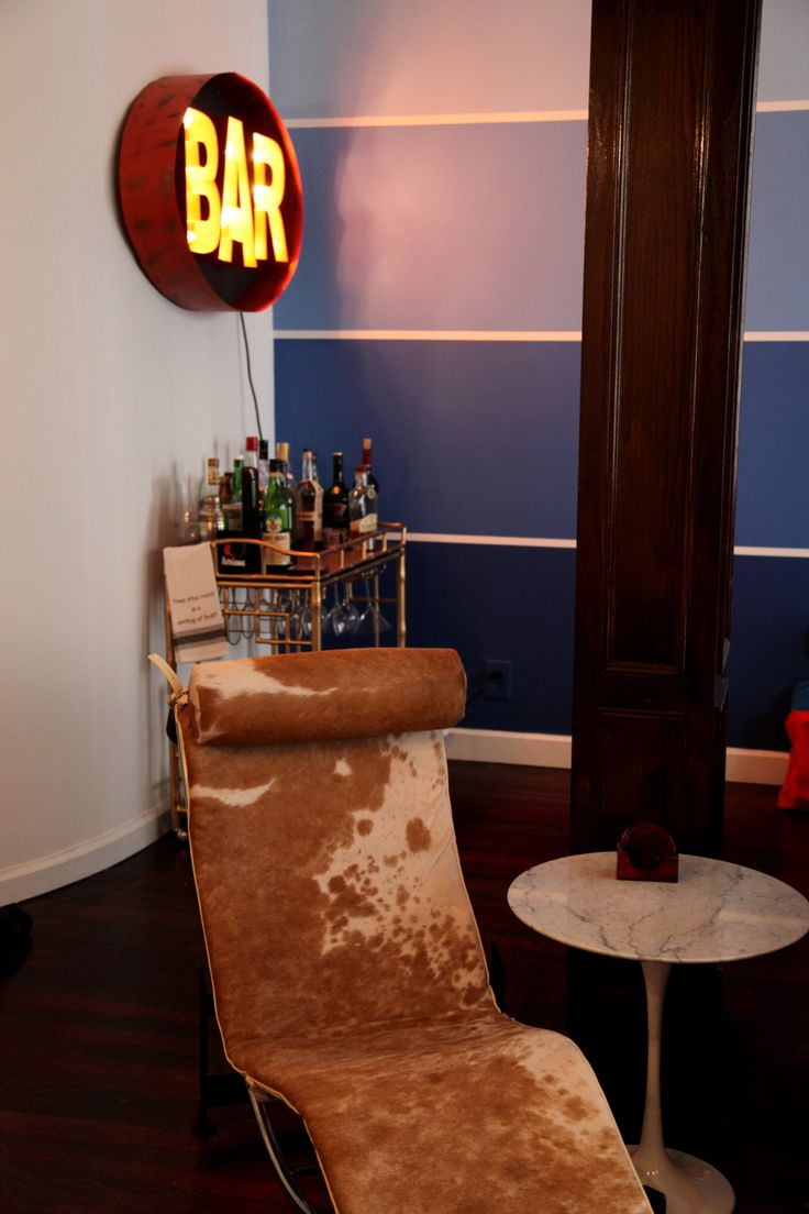 Feature Pantone wall, a Vintage BAR sign, and a lounge chair