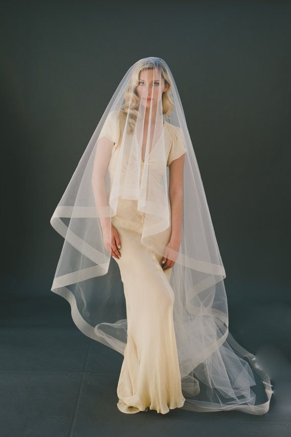 This lovely Drop Bridal Veil is lined with 2 Horsehair on the edge of soft Illusion Tulle. Its a simple drop veil that will compliment nearly any wedding gown. Cathedral length is shown on the model in champagne tulle. Its a Veiled Beauty wedding veil favorite! - 100% handmade in USA - 2 Horsehair Drop Wedding Veil #1203-2 - Cut from SOFT Bridal Illusion Tulle - Edged with 2 Horsehair Ribbon - Shown 108 with 30 blusher in Champagne Bridal Illusion Tulle - One hand-sewn 4 silver metal comb…