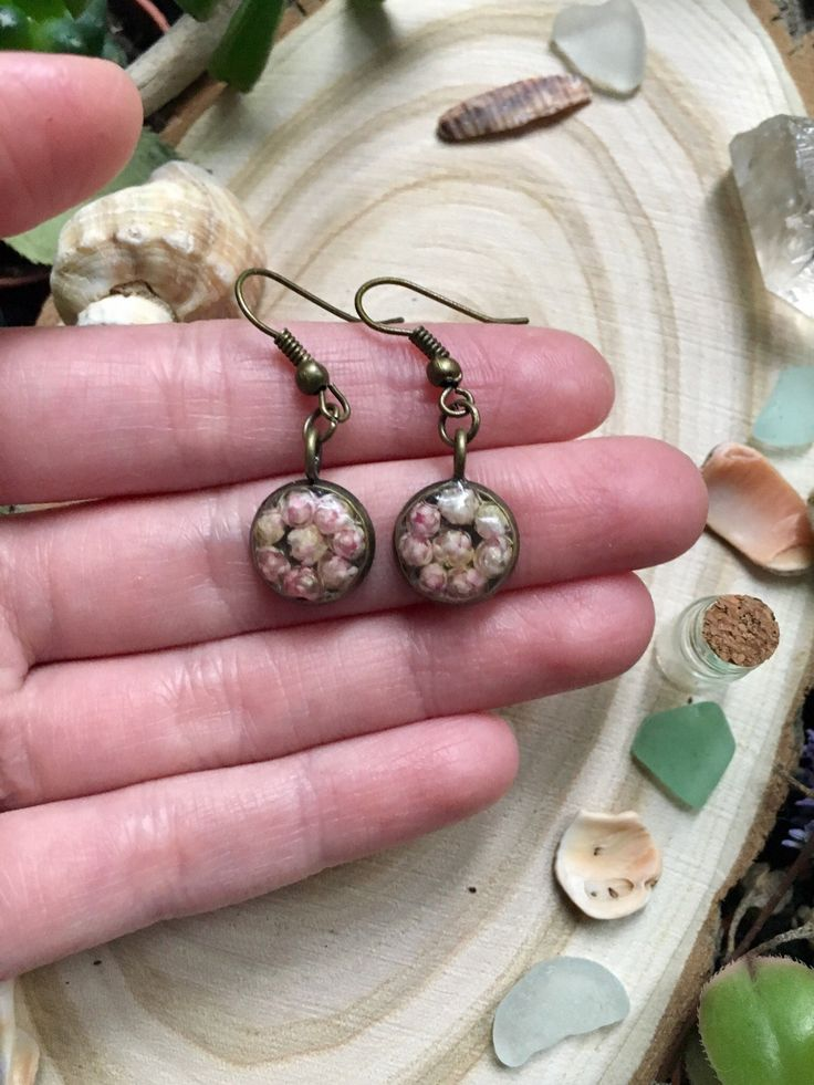 Earrings in vintage style. Central part - real flowers in resin.  Covered with hypoallegenic lacquer.