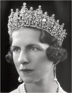 Queen Helen of Romania, born princess of Greece and Denmark, wearing her mother Queen Sophia of Greece's tiara (later Queen Frederica's.) Married to King Carol II of Romania prior to his accession, the mother of King Michael. Noted for her humanitarian efforts to save the Romanian Jews during the Second World War, which led to her being awarded the honorary title of Righteous Among the Nations