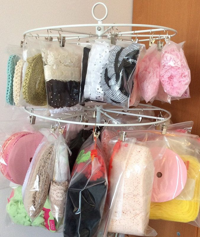 Ribbon/lace organization using the Michael's Recollections desktop carousel with 2-tier wire stand with clips.    by Eenie Q
