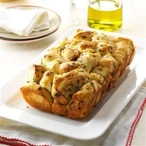 Pull-Apart Garlic Bread Recipe -People go wild over this golden, garlicky loaf whenever I serve it. There's intense flavor in every bite. —Carol Shields, Summerville, Pennsylvania