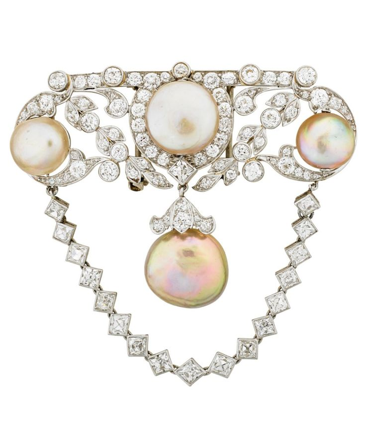 """A BELLE EPOQUE PLATINUM, NATURAL PEARL AND DIAMOND BROOCH, CIRCA 1915. Designed in the Louis style with a symmetrical arrangement of diamond set fronds or ribbons and three drilled button shaped pearls, suspending a swag chain of French cut diamonds around half drilled button pearl and diamond pendant. Unmarked. 2 1/8"""" x 2 3/8"""". #BelleÉpoque #brooch"""