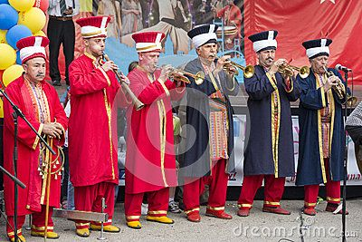 BUCHAREST, ROMANIA - MAY 17: Traditional Ottoman army band members perform at trumpets during the celebratory events Turkish Festival on May 17, 2013 in Bucharest, Romania.