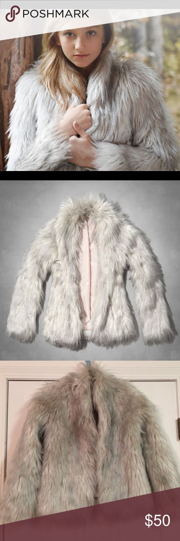 """Beautiful Grey faux fur coat Plush Faux fur Abercrombie Kids jacket size XL. Fits an adult size XXS-S (since there is no closure, it will fit a range of small sizes!) I'm an XS and it fits perfect.  Shoulder to shoulder 13"""" Armpit to armpit 17"""" Top to bottom 25"""" Abercrombie & Fitch Jackets & Coats Pea Coats"""