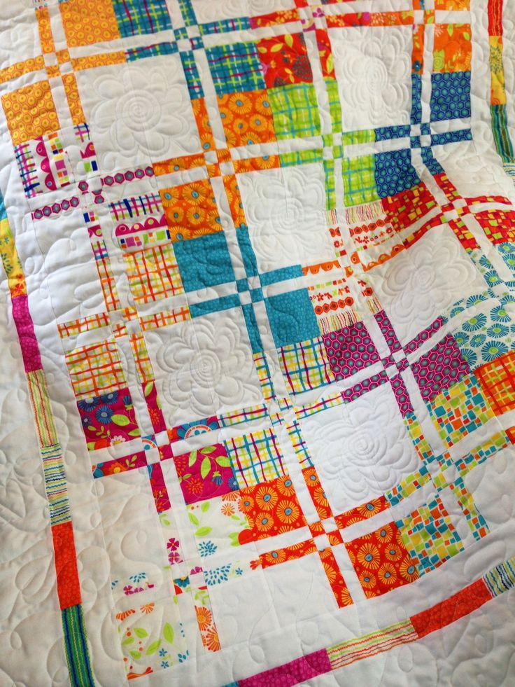 Disappearing four patch. Fabric is snap pop. Pieced by Michelle Thompson , quilted by Cathy Banker . Love it ;)