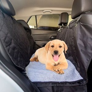 The Ultimate Waterproof Non-Slip Pet Back Seat Cover / Hammock for Dogs with Soft Washable Fleece Dog Bed. Attractive black quilted dog seat cover with contrasting fleece dog bed.