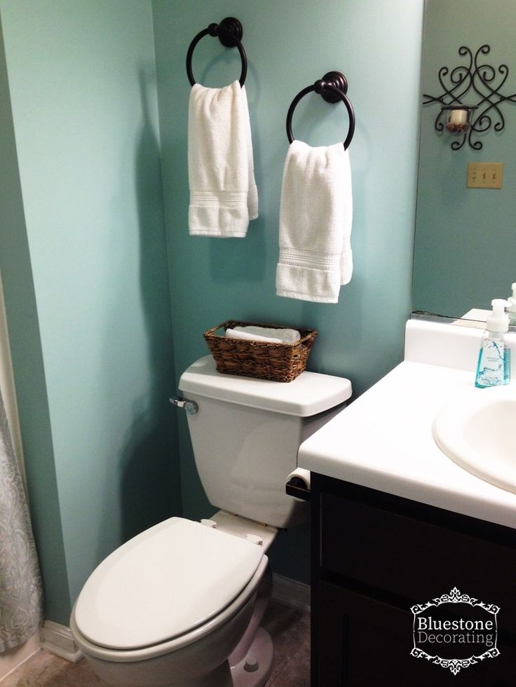 """Changing the paint color from the gray to Sherwin Williams """"Watery"""" gave this bathroom a spa-like feel."""
