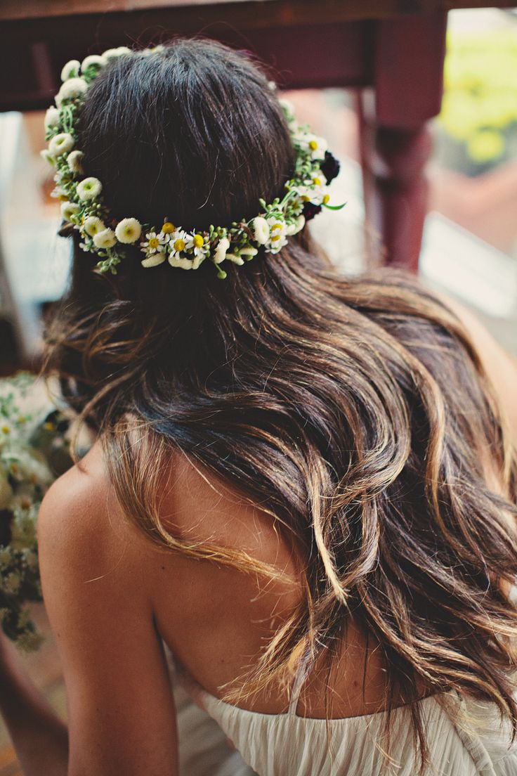 Pretty flower crown sun kissed brunette waves. Perfect.
