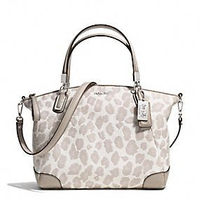 Have to have! I would normally never do a leopard purse but this one is understated and it has silver hardware!