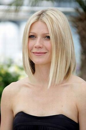 """parts the hair in the middle and the cut is at an angle -- a tad shorter in back than in front. According to the August 2008 issue of Allure Magazine, which features Gwyneth's bob, this look can be a tad boring if cut too blunt. Stacked layers in the back will """"give it some life,"""""""