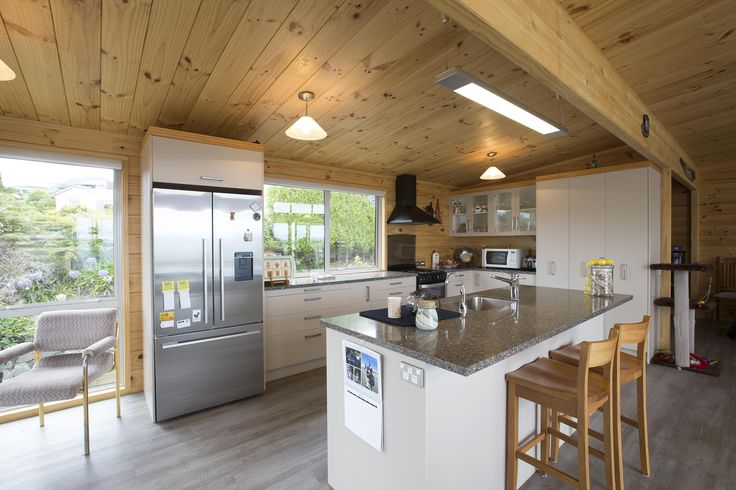 The modern kitchen was designed to create ease for Jenny around the kitchen, with special attention to what ways the cupboards open and the space between counters.