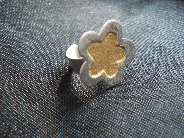 Sterling silver hand made ring, coating of gold leaf.