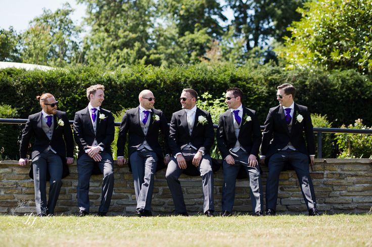 Matt and his groomsmen in classic black tails, grey waistcoat and purple cravats. Www.anthonyformalwear.co.uk