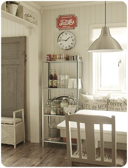 Bench. Lighting. Clock. White wood. pops of red...*love*