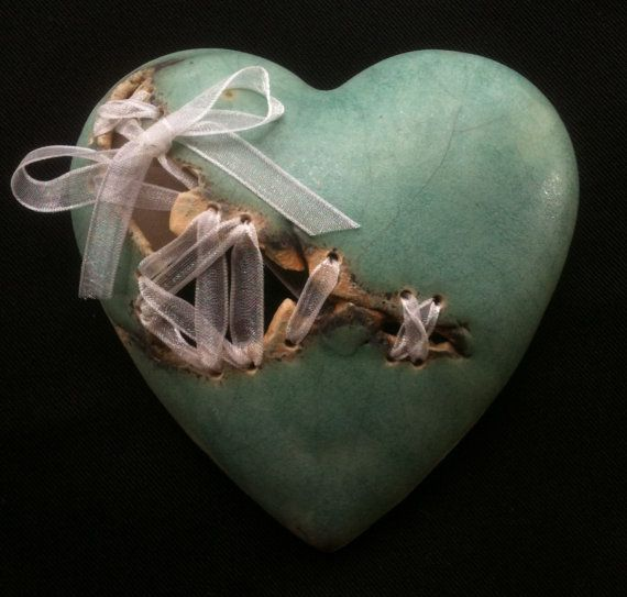 Handmade ceramic heart, in Green with ribbon stitches and bow. Individually made so no two are ever the same this unique gift will make a special valentine present for the love in your life. Green. height 9cm width 9cm