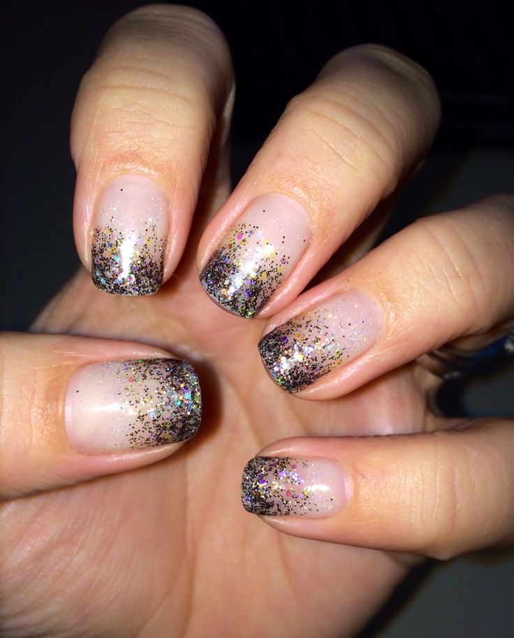 Gel nails. New Years gel nail design. Sparkles, glittery