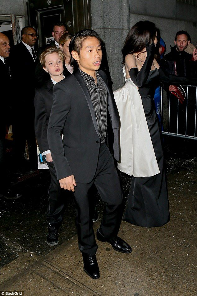 Dashing combo: Son Pax, 14, looked every inch the dapper gentleman in a black suit and tex...