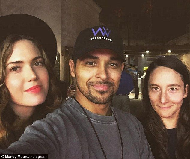 Reunited: Mandy Moore, left, cosied up to her ex-boyfriend Wilmer Valderrama, middle, at Universal Studios' Hollywood Horror Nights on Sunday. They are pictured here withRaina Penchansky, right