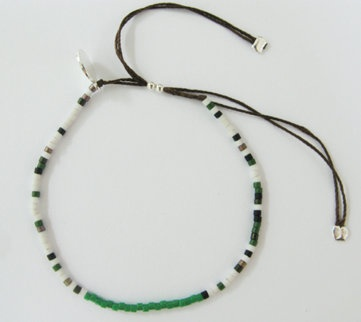 Camoflage friendship bracelet: White camoflage glass beaded bracelet on 100% silk thread.  size adjustable.  $30
