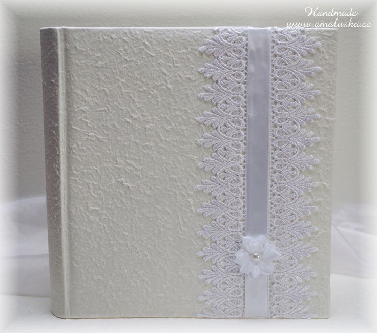 Wedding photo album with handmade paper, satin laces and ribbons.