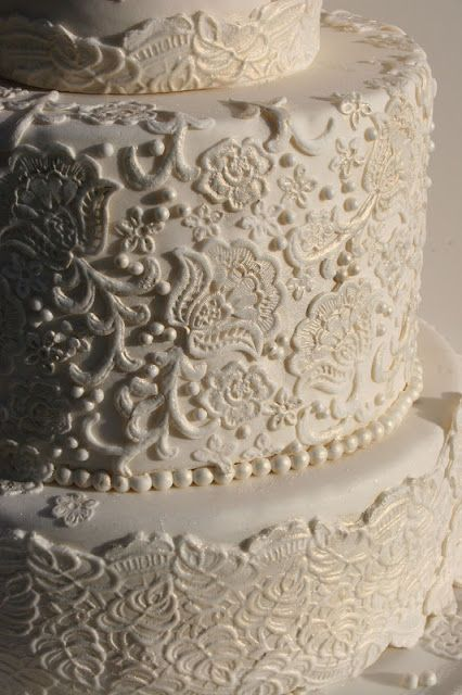 wedding cake with lace frosting...