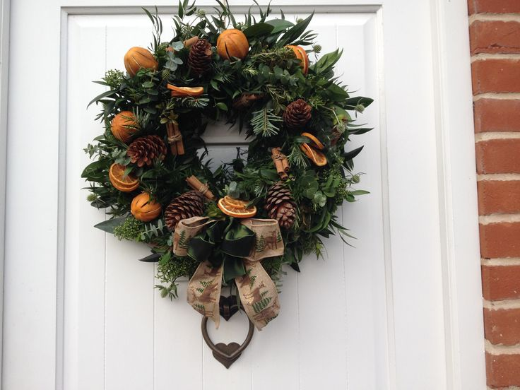 Large multi foliage #wreath with oranges, cinnamon sticks and pine cones.  Made by Wendy B.