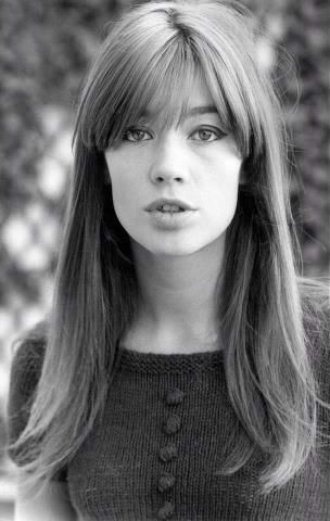 Francoise's parted bangs, and long brown hair.