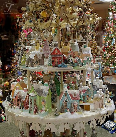 Cody Foster Folk Art, Putz Houses  and his trees on a round 2 tier table we designed and constructed to showcase his vintage houses.  There is an antique feather tree in the middle of it, coming out of the top tier full of vintage Christmas ornaments!: