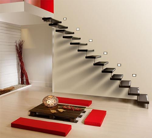 love how the red pops, and the FLOATING STAIRCASE