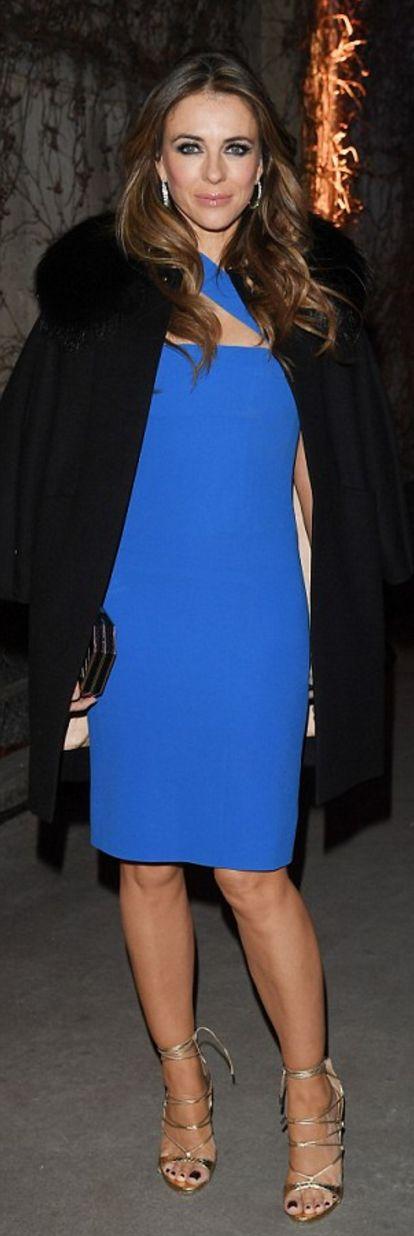 Who made  Elizabeth Hurley's blue one shoulder dress and gold lace up sandals?