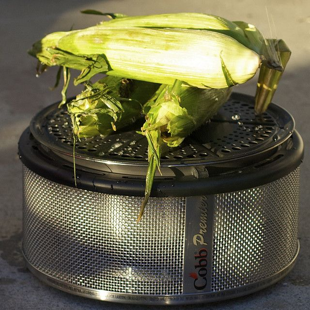 corn on the cob cooked in the Cobb Portable Charcoal Grill