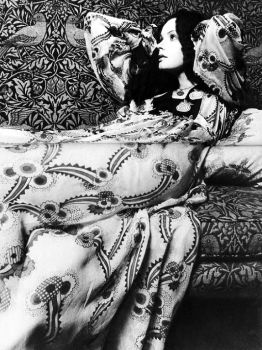Ossie Clark for Quorum, Vanity Fair, May 1970. Photographed by John Kelly at Wightwick Manor. The settee is covered in the Bird design by William Morris.
