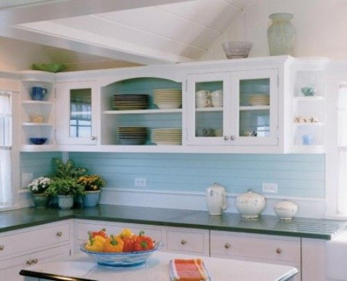White kitchen light blue backsplash glassed cupboards for Light blue kitchen backsplash