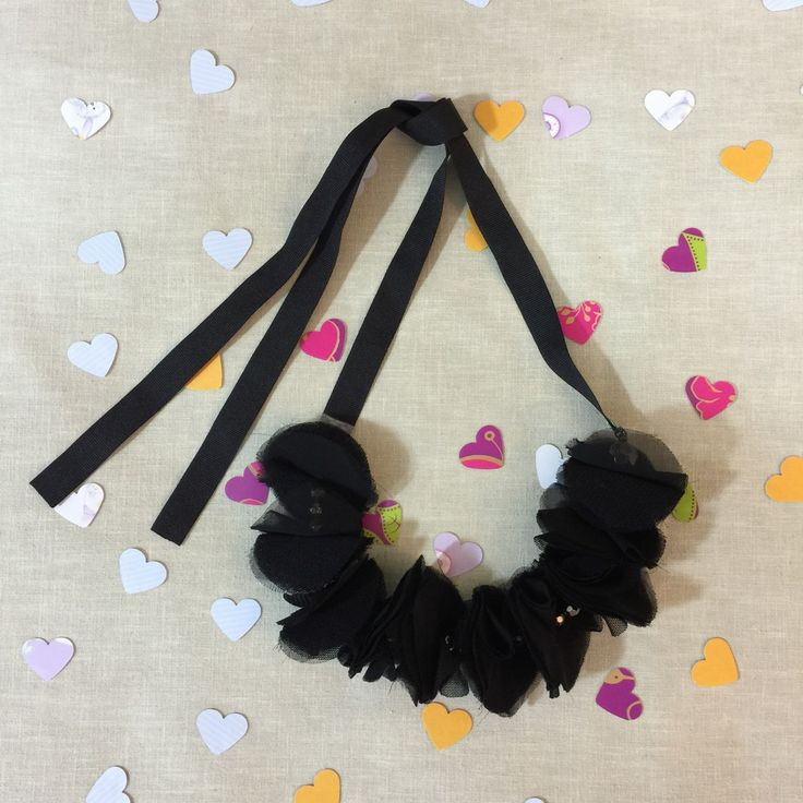 Classy and elegant black floral statement necklace decorated with beautiful fabric flowers. This necklace can be worn as a chocker or as a classic necklace.