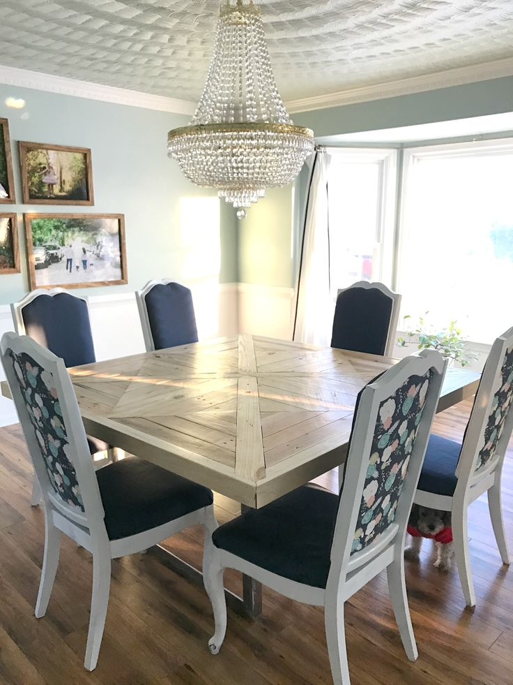 Reclaimed wood dining table with empire chandelier
