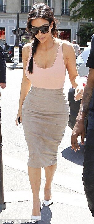 Kim Kardashian hit Paris in a suede pencil skirt and blush pink tank with an open back that revealed a lot of sideboob http://dailym.ai/10MjrAw