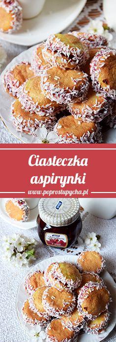 Ciasteczka aspirynki są idealnym dodatkiem do popołudniowej kawusi. To proste ciastka przełożone gęstą konfiturą z wiśni, ich boki obtoczone wiórkami kokosowymi, a wierzch i spód składa się z lekkiej bezowej powłoki <3 #poprostupycha #ciasteczka #konfitura #wiśnie #kokos #wypieki