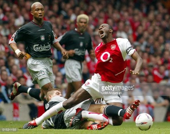Love this photo of a gruelling Steven Gerrard tackle on Patrick Vieira from behind. Both player wearing Predator Mania.  More great snaps of players in their Manias from this website.