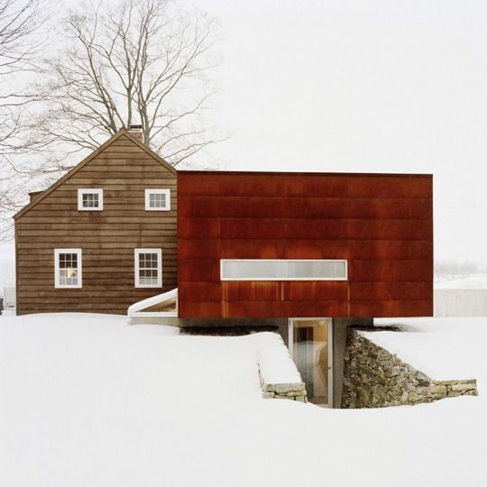 rustic + modern Interesting juxtaposition, unsure if it really works...perhaps if the square modern addition was similar color tone of original wood clad house, red tone seems too distracting.