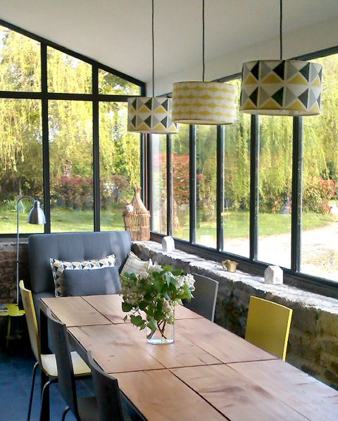 Dining room surrounded in windows that feels light and yet not too exposed.